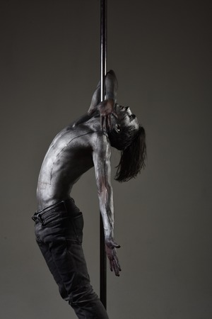 Flexibility in acrobatics and fitness health. flexibility of pylon man dancer