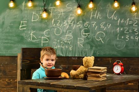 School food. Little boy have school food. Child enjoy school food. School food for schoolboy. Be smart, eat smart