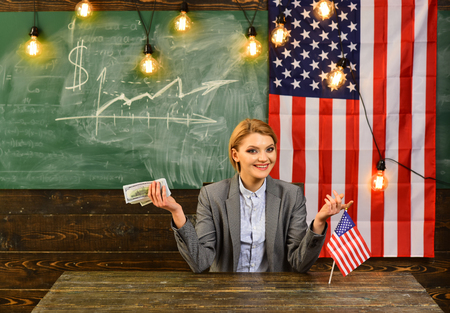 Woman with dollar money for bribe. American education reform at school in july 4th. Income planning of budget increase policy. Independence day of usa. Economy and finance. Patriotism and freedom