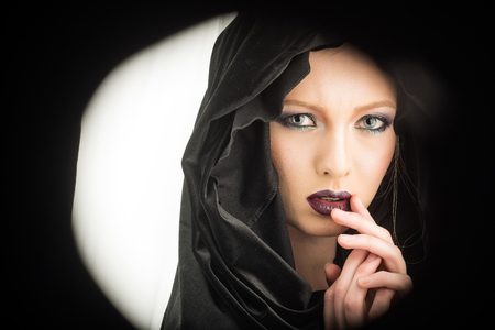 Black Friday concept. black friday in look of woman with hood and makeup