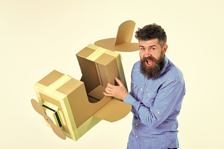 Air delivery. Dream, business, adventure. Air mail delivery, aircraft construction. Man engineer, pilot school, innovation. Bearded man father hold cardboard plane isolated on white. Pilot travel, airdrome dream Stockfoto