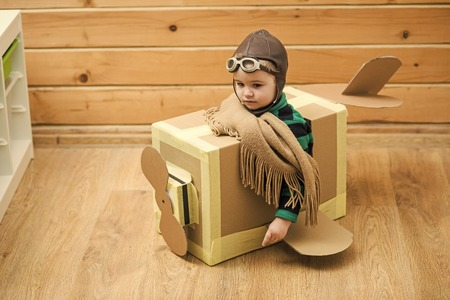 chidhood dream. Little Child Playing Airplane Pilot, Kid Traveler Flying in Aviator Helmet, Travel, Vacation Trip Concept