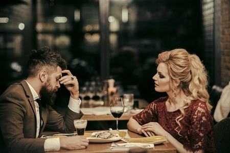 Unfortunate meeting. Cute Young Couple Arguing - Young adult couple arguing with expressions and gestures, out on a date Stock Photo