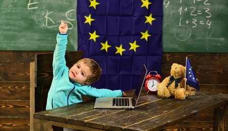 Idea concept. Little child got creative idea in classroom with eu flag. Genius child create idea with innovative technology. Idea and creativity. For the future we prepare Stock Photo