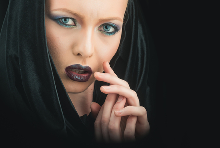 Fashion model with makeup of mysterious girl. fashion and beauty concept