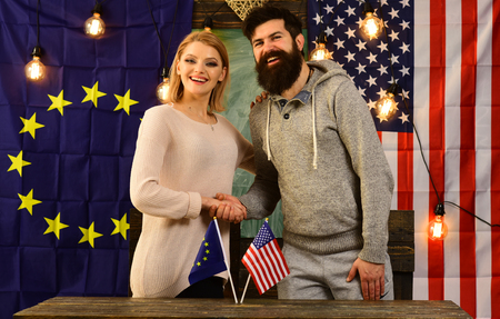 partnership between European union and USA flags. political relationship concept.