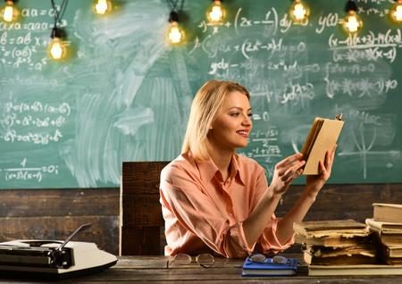education in modern school. education of pretty woman reading book