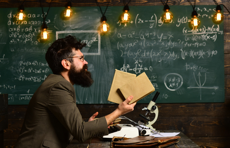 Bearded man hold books in university. Scientist research with microscope. Man with beard and mustache on chalkboard. Businessman in glasses at desk with retro typewriter. Research and knowledge