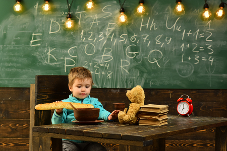Dieting and diet. Dieting, little boy eat french baguette at table. Healthy dieting for child. Dieting does the body good