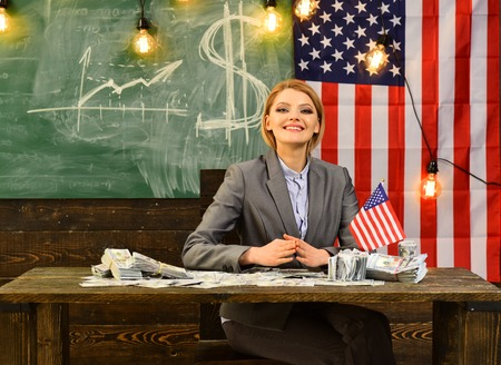 Woman with money banknote in school with american flag. Stock fotó - 104539909