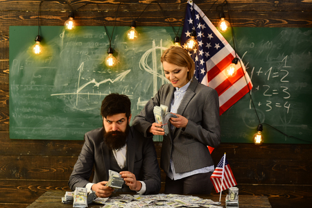 Independence day of usa. Income planning of budget increase policy. bearded man and woman with dollar money. American education reform at school in july 4. Economy and finance. Patriotism and freedom Stock fotó
