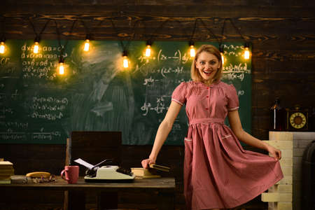 college time with happy retro woman in classroom. college education in modern life. college woman at work palce with smiling face.