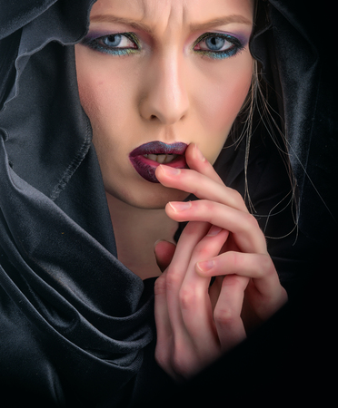 look of woman with makeup in black hood. look and beauty fashion concept. Banque d'images