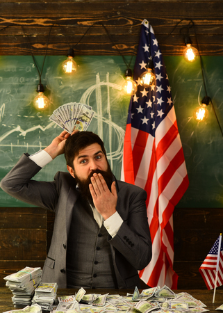 American education reform at school in july 4. american education budget with bearded man at usa flag Stock fotó