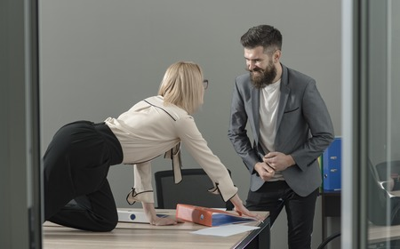 Office manager seduce boss on desktop. Office romance and sexual flirt concept