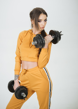gym. woman training in gym. gym sport training. fitness gym with sexy woman holding barbells. dedicated to fitness. Stock fotó