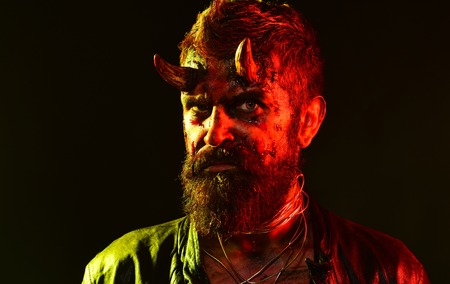 Halloween satan with beard, red blood, wounds on face