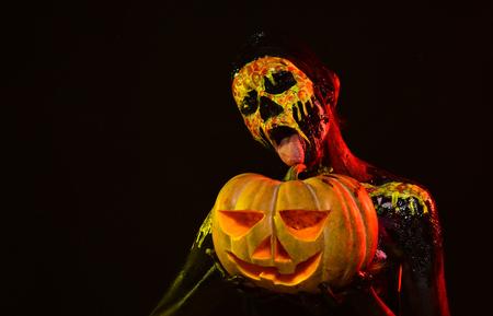 Halloween woman show tongue on skull makeup face
