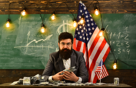 Bearded man with dollar money for bribe. Income planning of budget increase policy. Independence day of usa. American education reform at school in july 4. Economy and finance. Patriotism and freedom