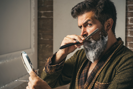 Barber Shop Studios.Sandalwood shaving cream. Hair Preparation is just for the dashing chap. Moustache Wax. Hair salon and barber vintage. Barbershop vintage. He is doing styling with the shaver.