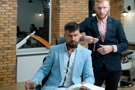 Senior man visiting hairstylist in barbershop. Professional hairstylist in barbershop interior. Hair Preparation is just for the dashing chap. Hair style and hair stylist.