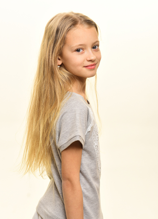 stylish kid. stylish kid with long blond hair. stylish kid isolated on white. stylish kid and beauty fashion. Standard-Bild