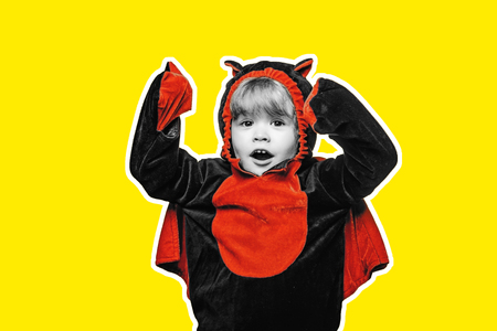 Child play in costume dracula. Halloween decoration and scary concept. Halloween wide banner. Scary face. Advertisement Halloween concept with isolated stickers.