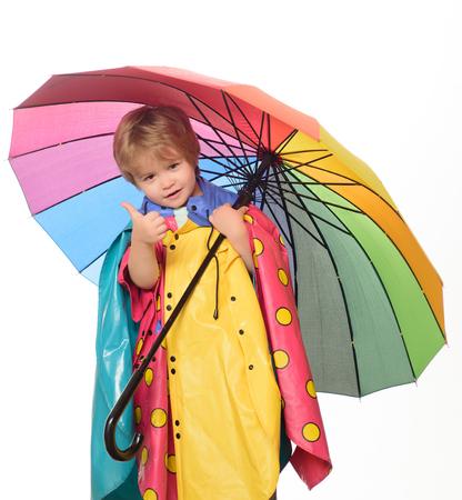 Rain and umbrella concept. Autumn Clothing. Portrait of a beautiful happy little boy close-up. Cute little boy. Family childhood lifestyle concept.