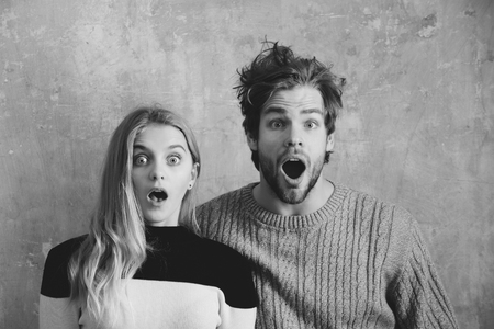 Wow Surprised man and woman with open mouth, young couple