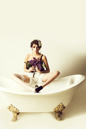 young woman resting in spa bathtub with fashionable hair, lilac Stock Photo - 108160570