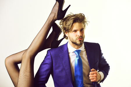 businessman in suit and female sexy legs