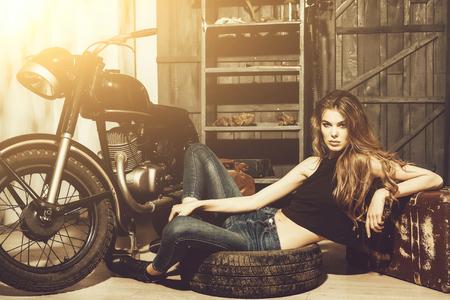 girl lying in dirty rubber tire on floor