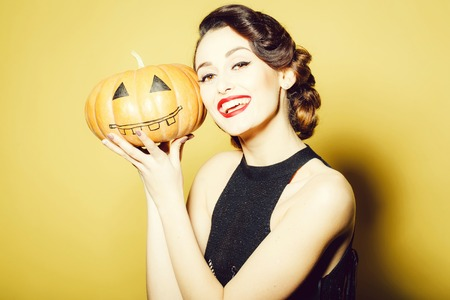 Young woman with Halloween pumpkin Stock Photo