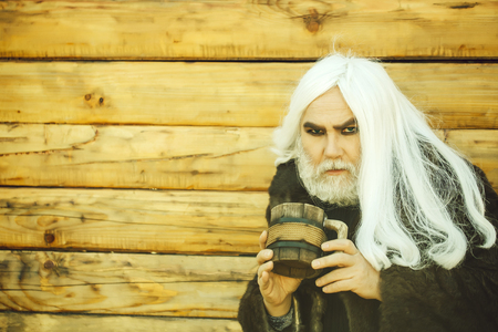 bearded man with wooden mug Stock fotó