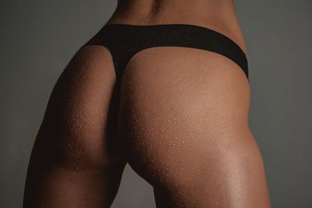 Elegant sexy woman in the black bikini. Sexy ass female in panties. Sexy butt. Nude sensual woman with perfect body