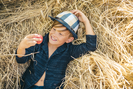 Autumn Clothing and color kids trends. Autumn child with autumnal mood. Boy on a breeze in an autumn village. Autumn time for kids Fashion sale.