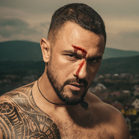 Male scars and boxing. Dangerous sports. Brutal fist fighter in the blood. Strong look of a man.