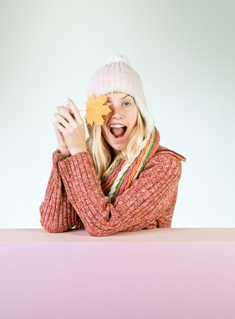 Funny autumn face. Ready for text slogan or product. Funny blonde woman advertises your products. Free autumn time.