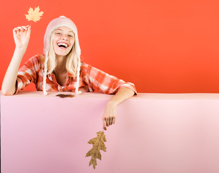 Funny autumn face. Ready for text slogan or product. Funny blonde woman advertises your products. Autumn happy people and joy. Free autumn time. Crazy people. Stock Photo
