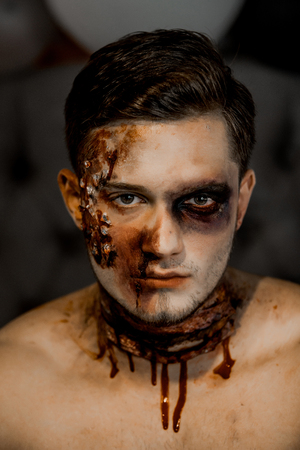 Halloween man with zombie face.