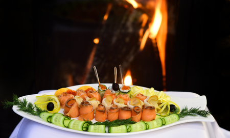 Assorted fish platter with lemon and cucumber. Serving fish platter of organic redfish and whitefish fillet in assortment in restaurant. Where food speaks with your palate