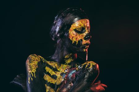 Halloween woman with skull face paint drool saliva