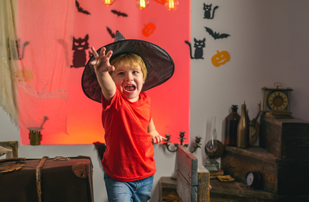 Child having fun at Halloween trick or treat. Children in america celebrate halloween. Expression face. Crazy people. Banco de Imagens