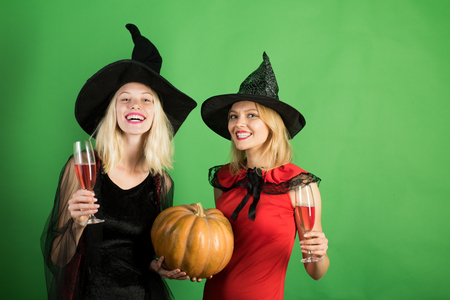 Halloween party. Best friends girls celebrates Halloween. Having fun. Surprised woman. Happy brightful positive moments of two stylish girls. Halloween copy space.