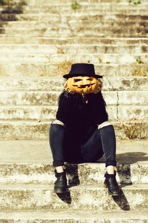 halloween girl with pumpkin