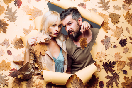 Autumn couple wearing in autumn clothes and looks very sensually. Autumn trend and vogue. Hello September. Stock Photo