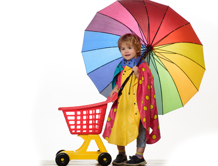 Little Man are getting ready for shoping and autumn sale. The autumn mood and the weather are warm and sunny and rain is possible. People in rain. Isolated object on white background. Stok Fotoğraf