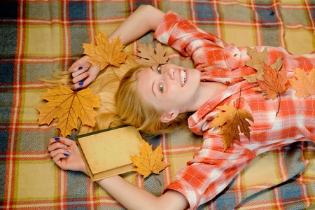 Happy young woman are preparing for autumn sunny day. Autumn time for Fashion sale. Top view.