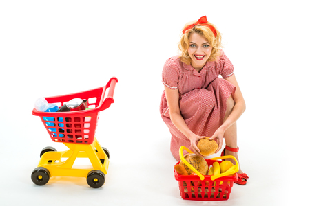 Shopping time. shopping girl with full cart. vintage housewife woman isolated on white. retro woman go shopping. happy woman going to make payment in supermarket. savings on purchases. Online shop.