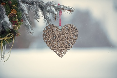 new year and valentines day, heart decoration on christmas tree